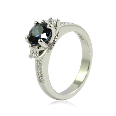 Round-sapphire-diamond-engagement-ring-bentley-de-lisle