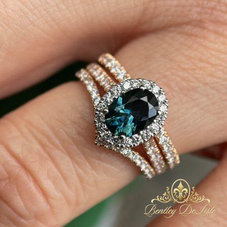 Teal-green-australian-sapphire-halo-ring-bentley-de-lisle-hand-bridal-set