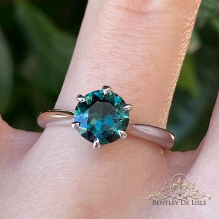 Teal-Australian-sapphire-solitaire-ring-hand-bentley-de-lisle
