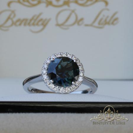 Teal-Round-Sapphire-Halo-Engagement-Ring-box-bentley-de-lisle