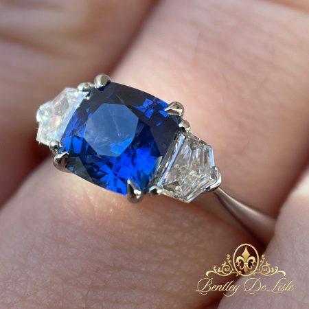 Cornflower-Cushion-Sapphire-Three-Stone-Ring-hand-bentley-de-lisle