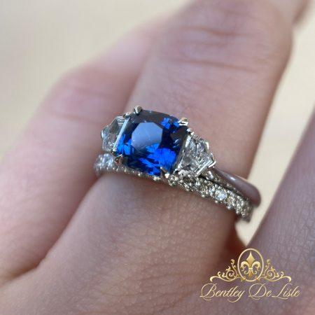 Cornflower-Cushion-Sapphire-Three-Stone-Ring-wedding-hand-bentley-de-lisle