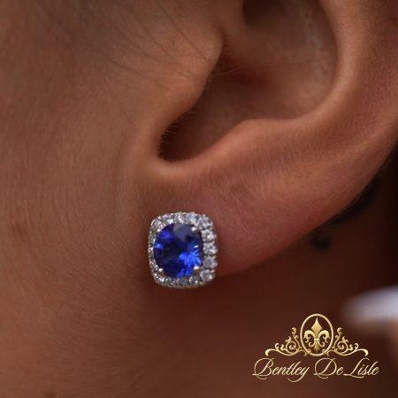 Royal-blue-sapphire-diamond-cluster-earrings-model-bentley-de-lisle