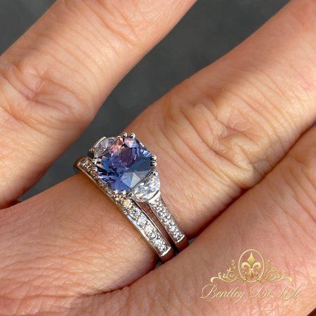 Violet-blue-sapphire-diamond-ring-hand-2-bentley-de-lisle-900px
