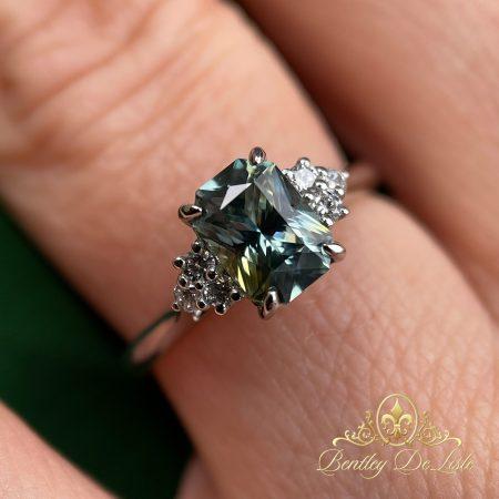 Yellow-blue-sapphire-diamond-ring-bentley-de-lisle-hand